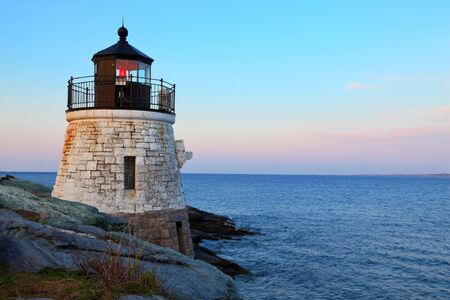 newport: Castle Hill Lighthouse in Newport Rhode Island at sunrise