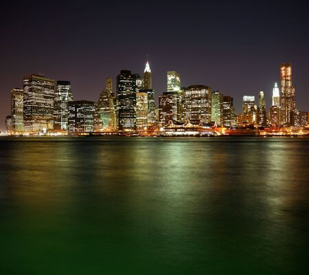 Lower Manhattan in New York City at night with reflection in water Stock Photo - 7092001