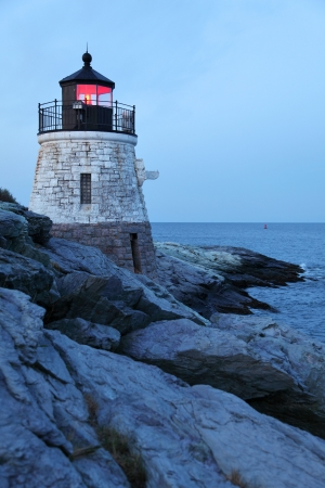 newport: Castle Hill Lighthouse in Newport Rhode Island just before dawn