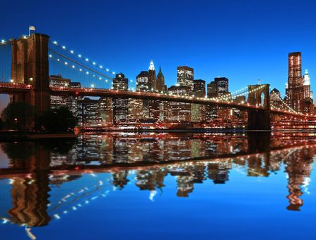 low: Historic Brooklyn Bridge and lower Manhattan reflected in East River