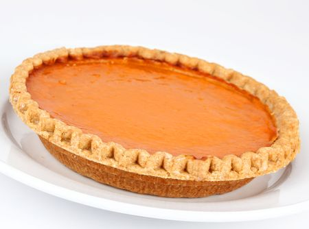 Pumpkin and sweet potato pie on white background