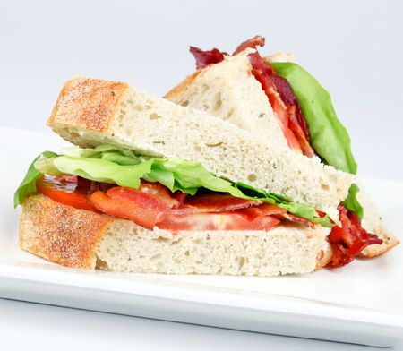 Bacon, lettuce and tomato sandwich on a white plate Stock Photo