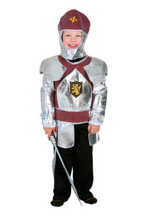 Young boy dressed as a Halloween Knight isolated on white photo