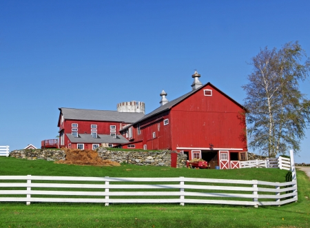 barnyard: Traditional typical looking American building with white fence