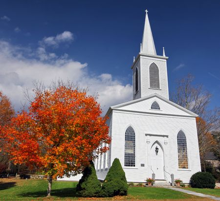church steeple: Traditional American white church in the fall