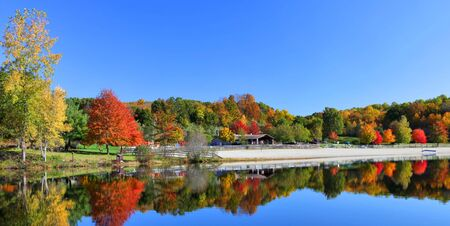 Stunning New England lake in fall with blue sky  Stock Photo - 8201508
