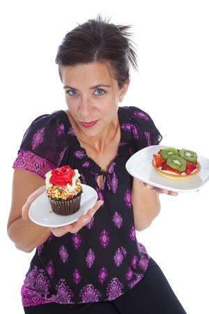 Atractive woman with two desserts in studio photo