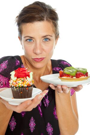 Attractive woman holding and offering two desserts  photo