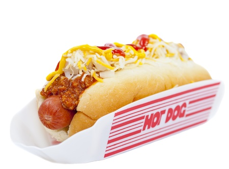 Hot dog with chili, raw onion and sauce on white