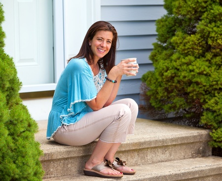 30 to 40: Beautiful woman taking a coffee break holding a mug