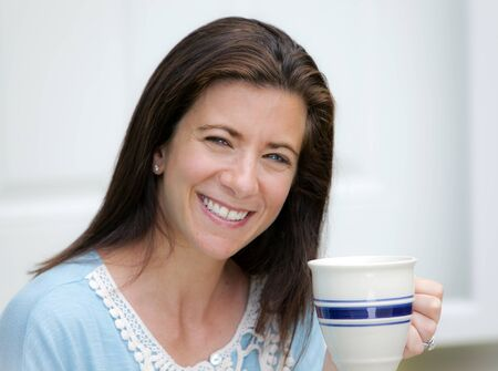 Young attractive woman holding a mug of coffee photo