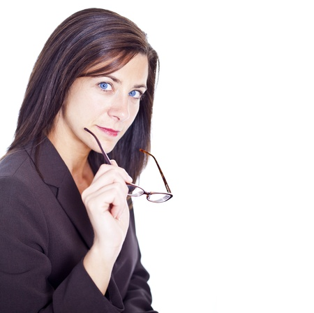 Attractive businesswoman holding glasses on white background