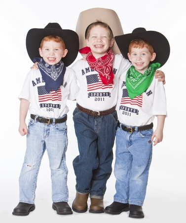 playtime: Three boys dressed up as cowboys in studio