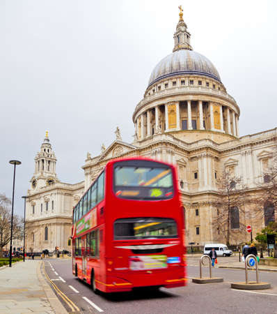 unmarked: St. Pauls Cathedral with red bus in London