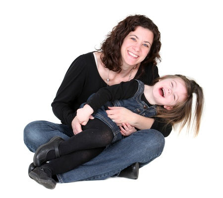 tickling: Mother and daughter plating isolated on white Stock Photo