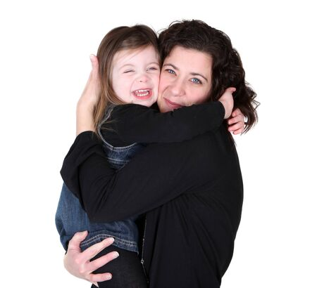 Mother and daughter embracing studio portrait photo