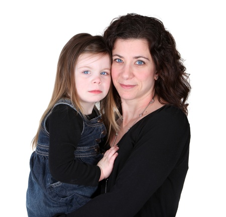 love sad: Mother and daughter embracing studio portrait Stock Photo