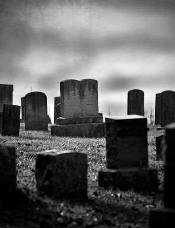 christian halloween: Very old misty and creepy graveyard in black and white