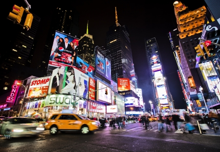 NEW YORK CITY - NOV 13: Times Square, is a busy intersection of art and commerce where electronic, neon and illuminated signs vie for tourists attention on this iconic street of New York and America, November 13th, 2011 in Manhattan, New York City. Stock Photo - 11336690
