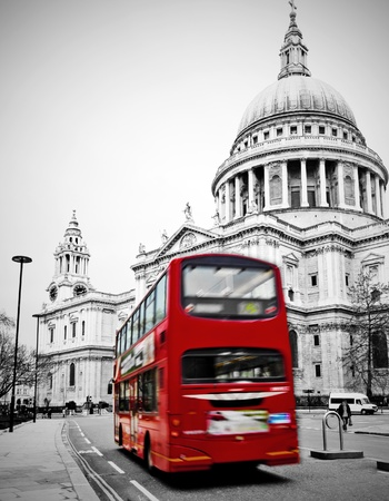 winter road: St. Pauls Cathedral with red bus in London