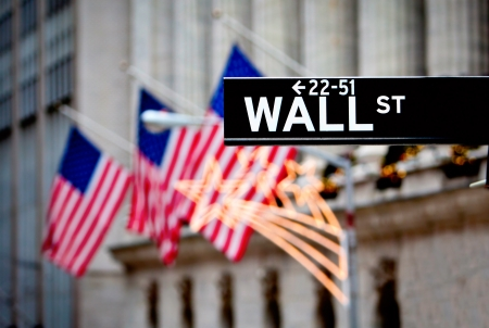 Wall street sign in New York with New York Stock Exchange background  Stock Photo