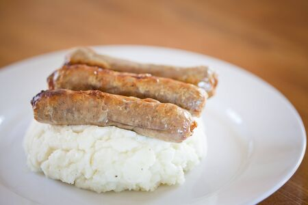 Sausages with mashed potatoes and fried onions at the pub