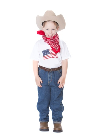 Little boy dressed as a cowboy on white photo