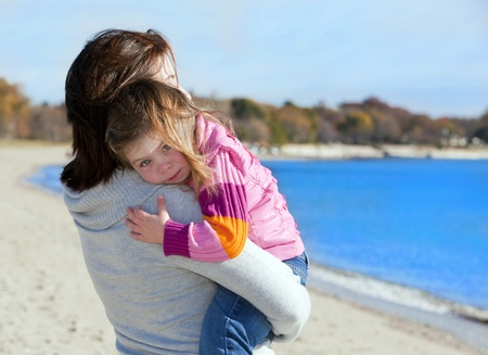 Mother and daughter outside at the beach photo