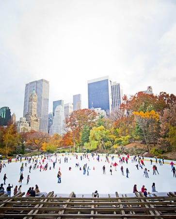 rink: Ice skaters having fun in New York Central Park in fall