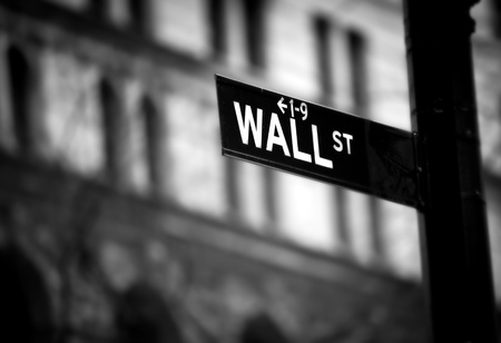 stock: Wall Street sign in lower Manhattan New York