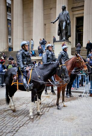 NEW YORK CITY - DEC 27: New York Police officers on horseback as part of the highly visible security on Wall Street outside the Federal Hall and Stock Exchange, December 27th, 2011 in Manhattan, New York City.