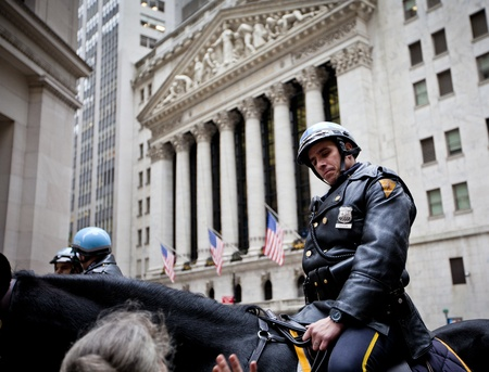 nasdaq: NEW YORK CITY - DEC 27: New York Police officers on horseback as part of the highly visible security on Wall Street outside the Federal Hall and Stock Exchange, December 27th, 2011 in Manhattan, New York City.