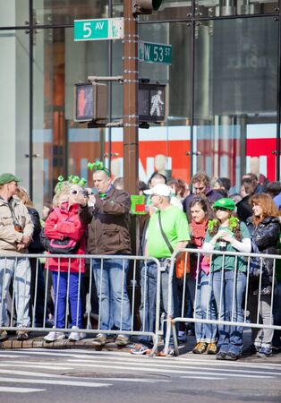 NEW YORK, NY, USA MAR 17: Crowds of people gather to celebrate at the St. Patrick's Day Parade on March 17, 2012 in New York City, United States. Stock Photo - 13062663