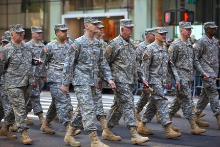 NEW YORK, NY, USA MAR 17: Marching US miltary soldiers from the 69th Infantry at the St. Patrick's Day Parade on March 17, 2012 in New York City, United States.