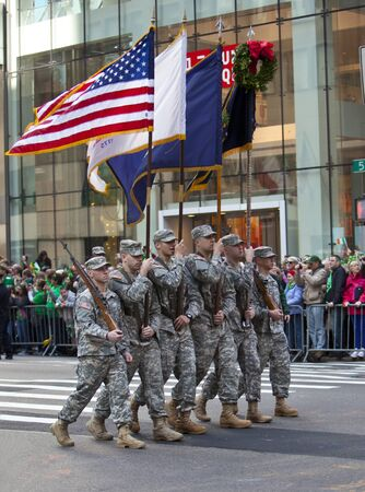 NEW YORK, NY, USA MAR 17: Marching US miltary soldiers from the 69th Infantry at the St. Patrick's Day Parade on March 17, 2012 in New York City, United States. Stock Photo - 13062593