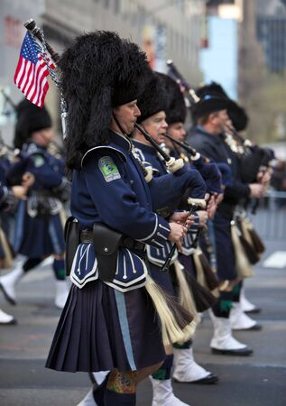 NEW YORK, NY, USA MAR 17: NYPD bagpiper policemen at the St. Patrick's Day Parade on March 17, 2012 in New York City, United States. Stock Photo - 13062630