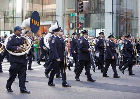 NEW YORK, NY, USA MAR 17: NYPD marching band policemen at the St. Patrick's Day Parade on March 17, 2012 in New York City, United States. Stock Photo - 13062629