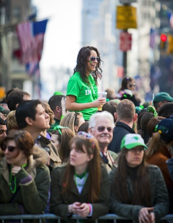 NEW YORK, NY, USA MAR 17: Crowds of people gather to celebrate at the St. Patrick's Day Parade on March 17, 2012 in New York City, United States. Stock Photo - 13062573