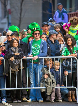 NEW YORK, NY, USA MAR 17: Crowds of people gather to celebrate at the St. Patrick's Day Parade on March 17, 2012 in New York City, United States. Stock Photo - 13062667