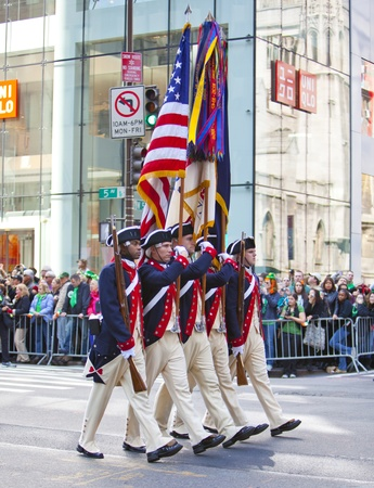 NEW YORK, NY, USA MAR 17: Marching US miltary soldiers in traditional historic uniform at the St. Patricks Day Parade on March 17, 2012 in New York City, United States.