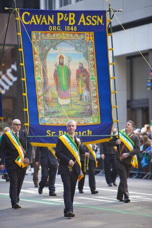 NEW YORK, NY, USA MAR 17: Honorable participants carrying banner at the St. Patrick's Day Parade on March 17, 2012 in New York City, United States. Stock Photo - 13062665