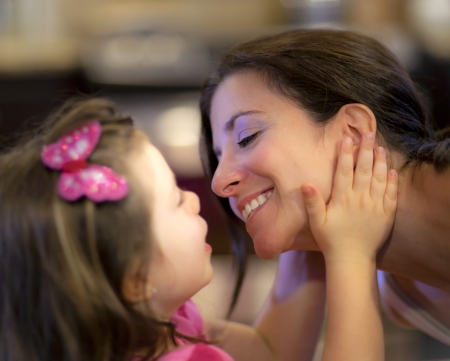 true love: Beautiful mother and daughter share a tender moment