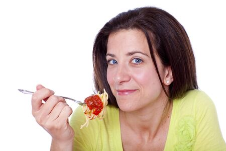 Pretty woman holding a fork with spaghetti portrait  photo