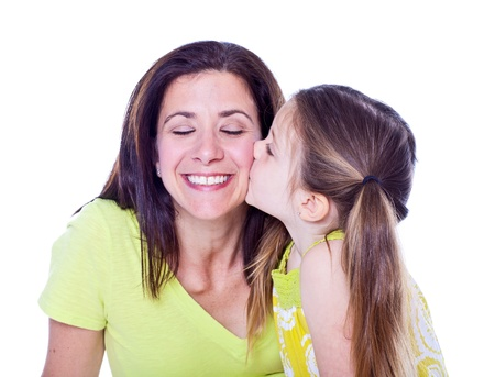 Pretty mother and daughter studio portrait on white