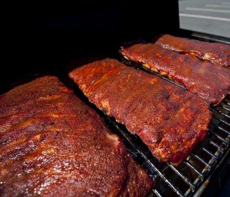 back rub: BBQ ribs cooking on a hot grill