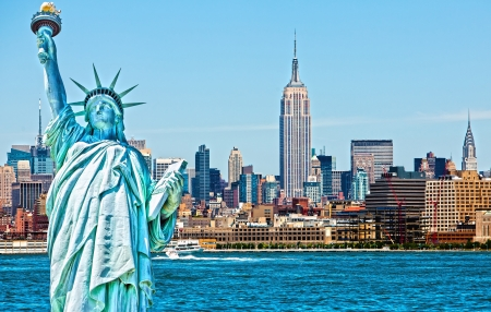 Statue of Liberty cut out over New York skyline background photo