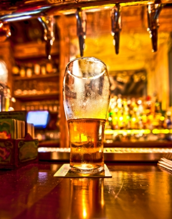 counter top: Pint of beer on a bar in a traditional style pub  Stock Photo