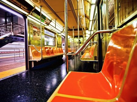 new york: New York subway car interior with open door