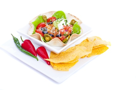 Taco salad in a baked tortilla on white background photo