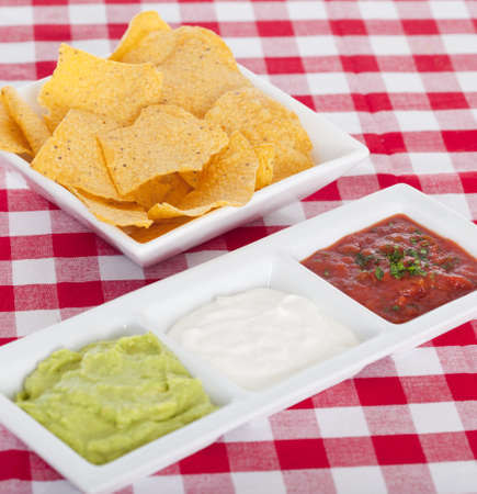 Three Mexican dips and tortilla chips 免版税图像